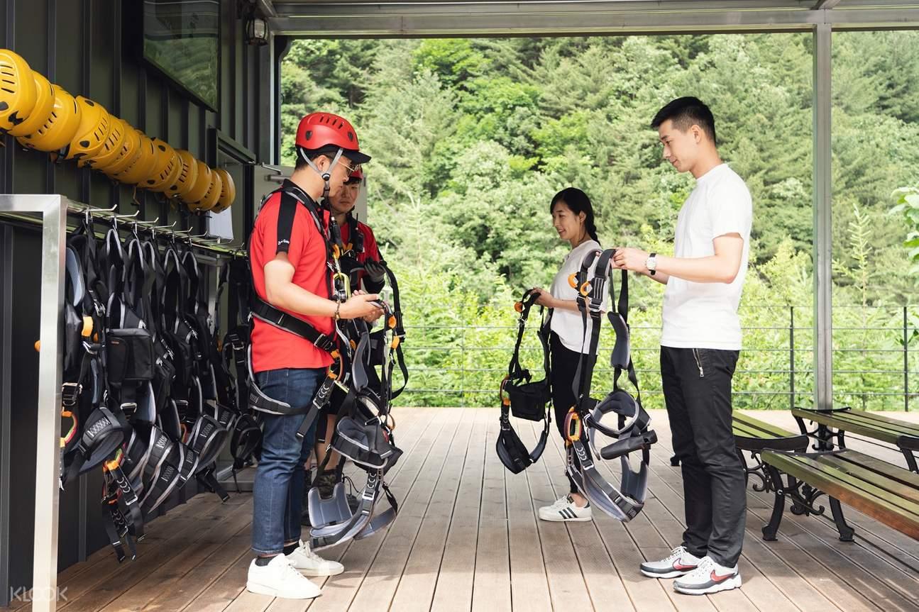 staff of Gapyeong zipline instructing a couple