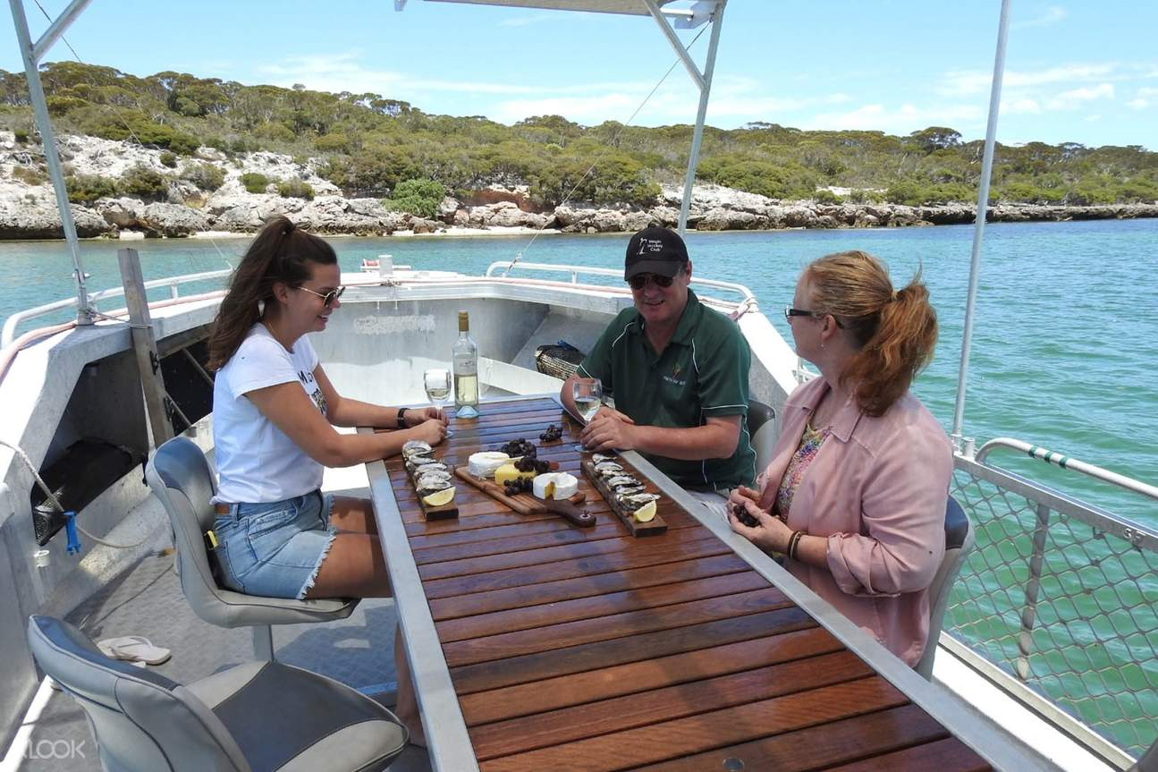 people on boat riding to coffin bay