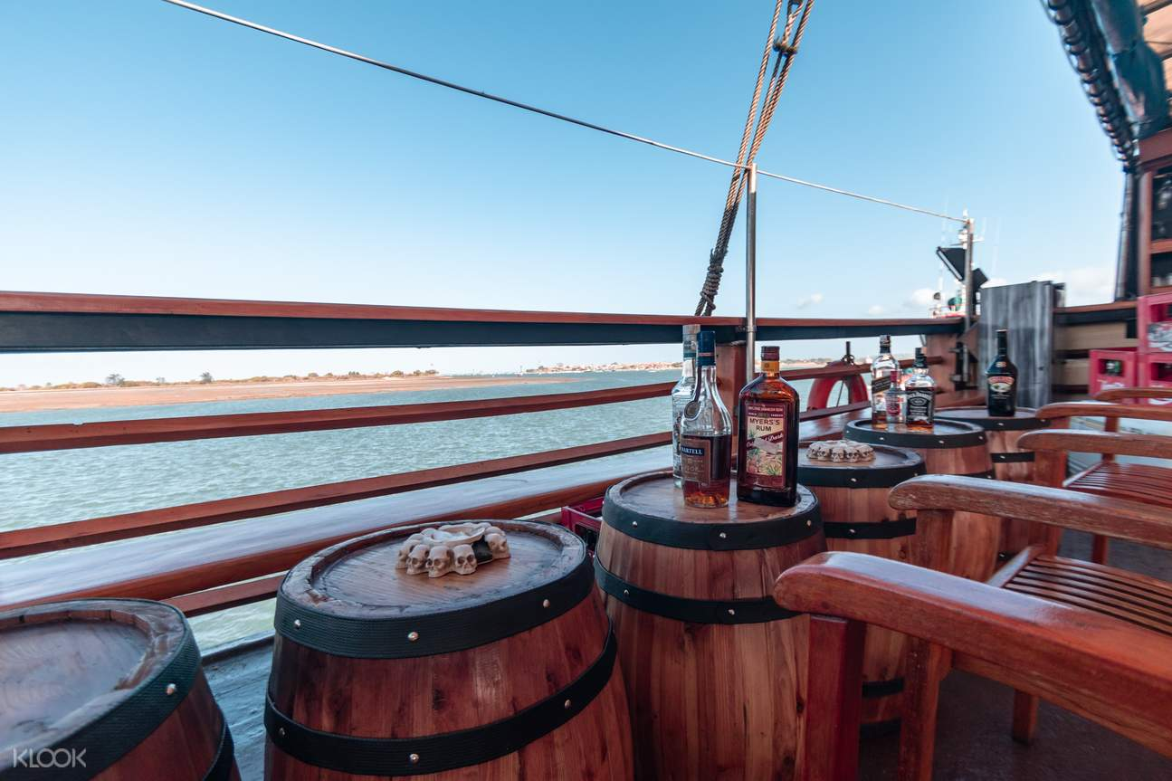 a view of chairs, barrels, and alcoholic beverages on the cruise vessel