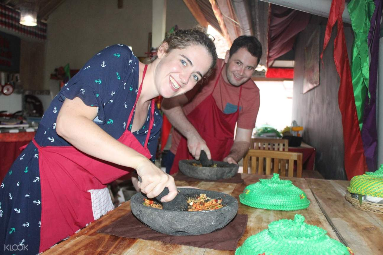 two people cooking