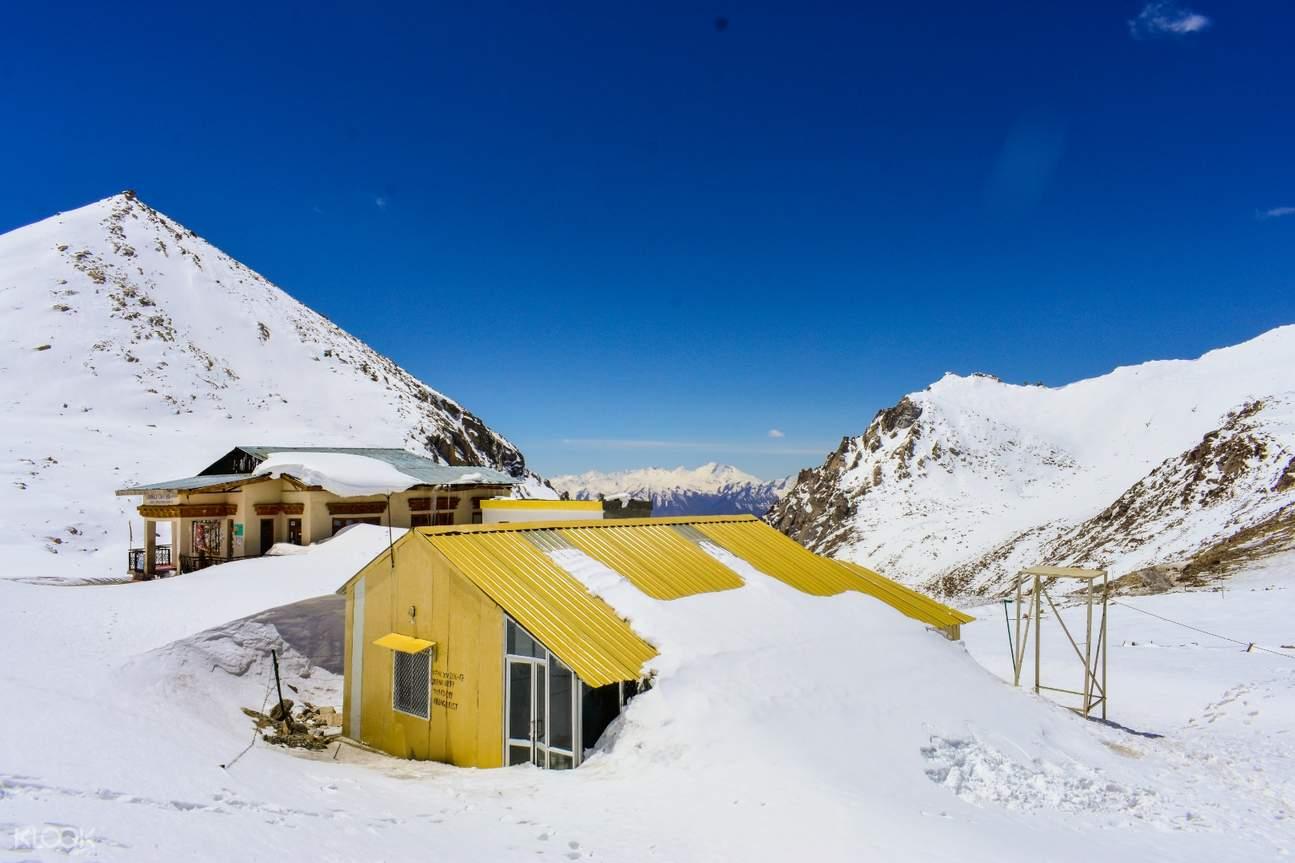 house in snow at tripver leh ladakh