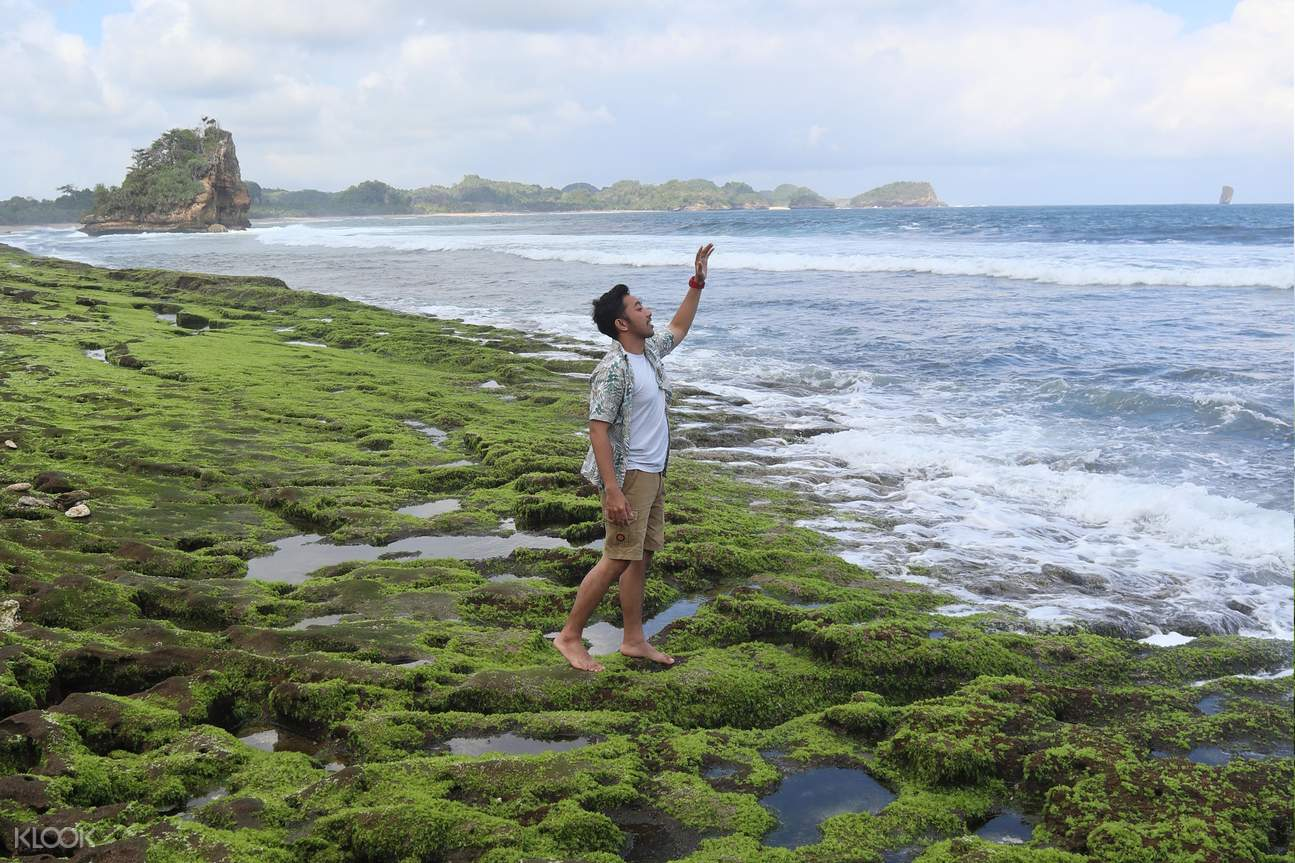 man on beach in malang