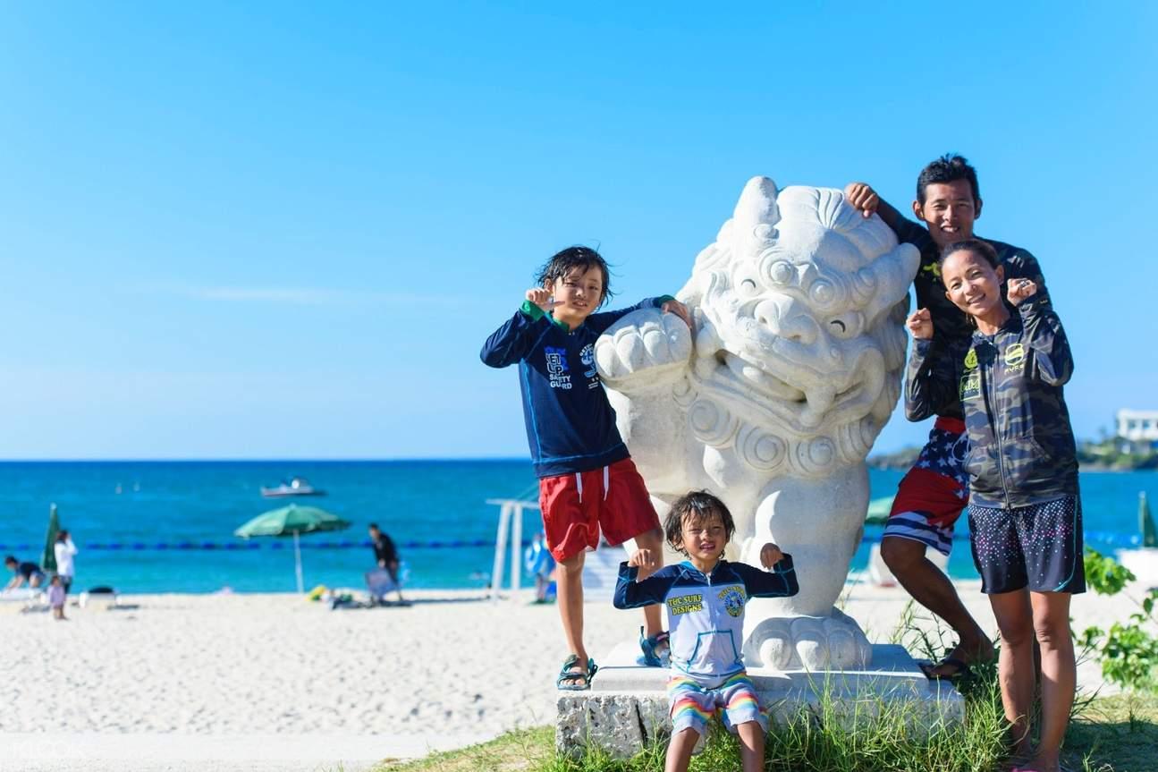 family posing at a beach