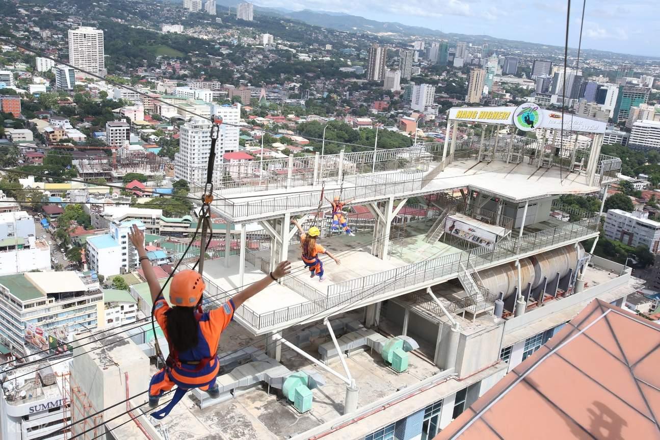 tourists enjoy the zip line in cebu