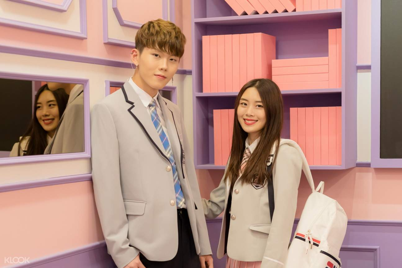 a boy and a girl wearing school uniforms at ehwa gyobok's studio