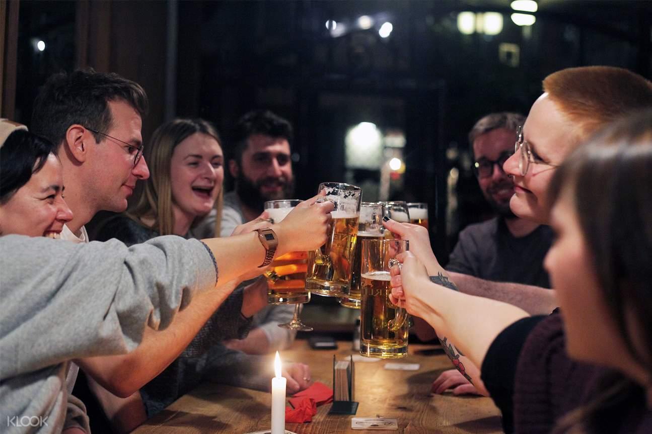 tourists enjoy a mug of craft beers in hamburg