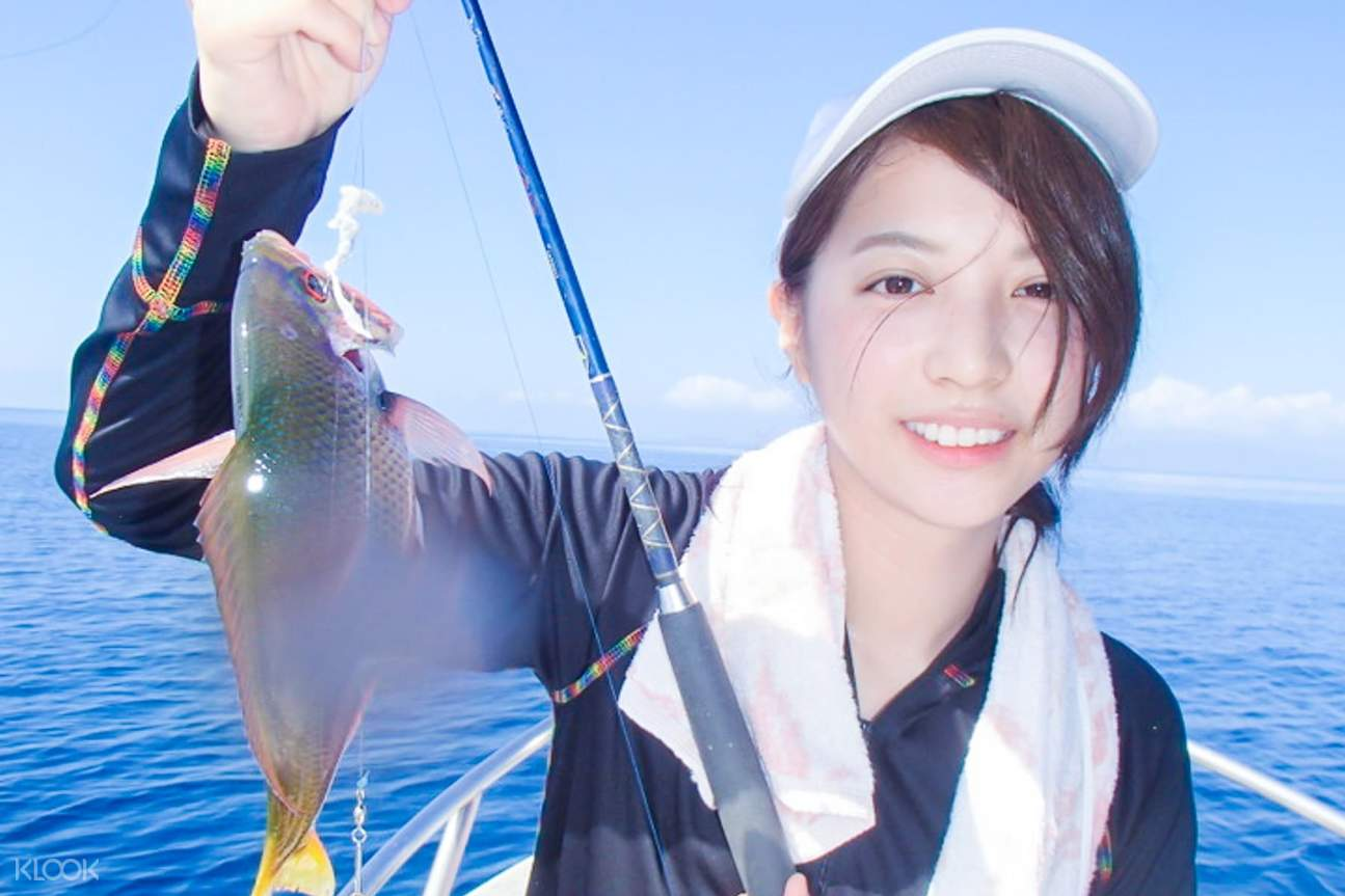 Photo of participant and the fish caught during the fishing tour