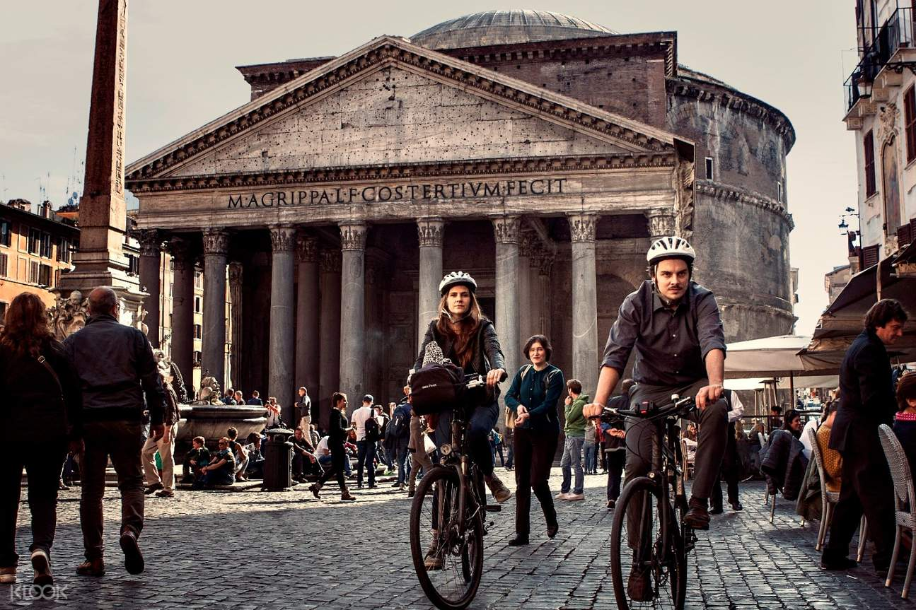 Tourists riding in front of the Pantheon