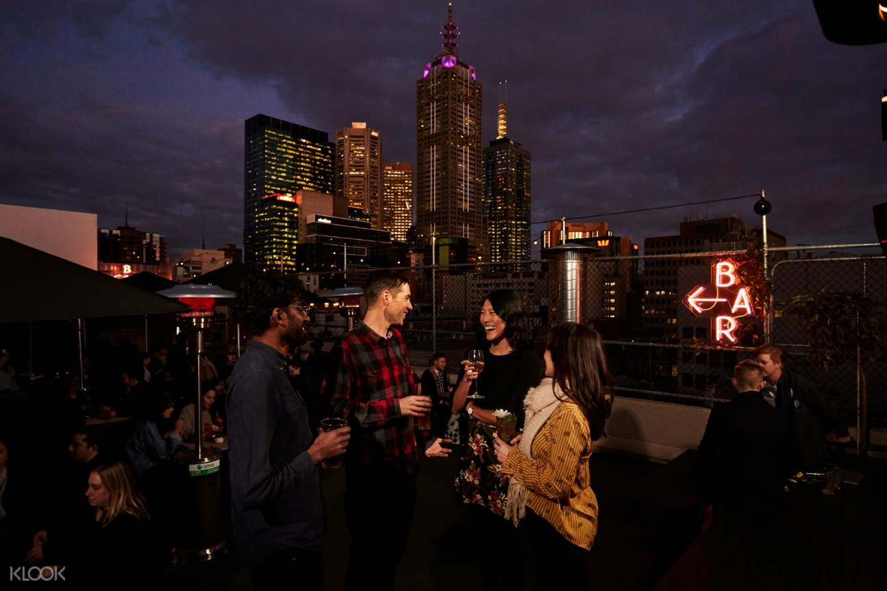 friends drinking on a rooftop bar