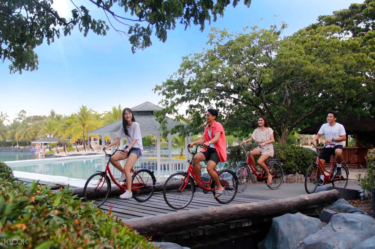 teens biking in plantation bay