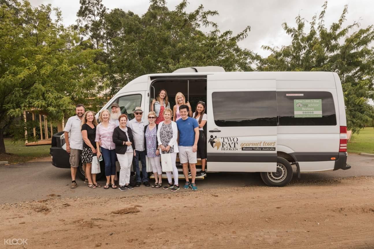 tourists posing in van