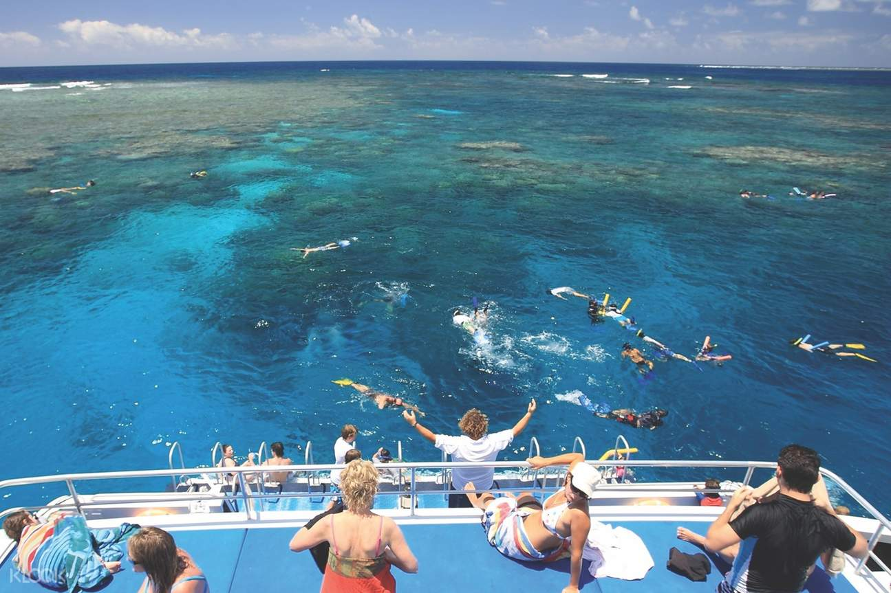 people snorkeling and back deck of boat