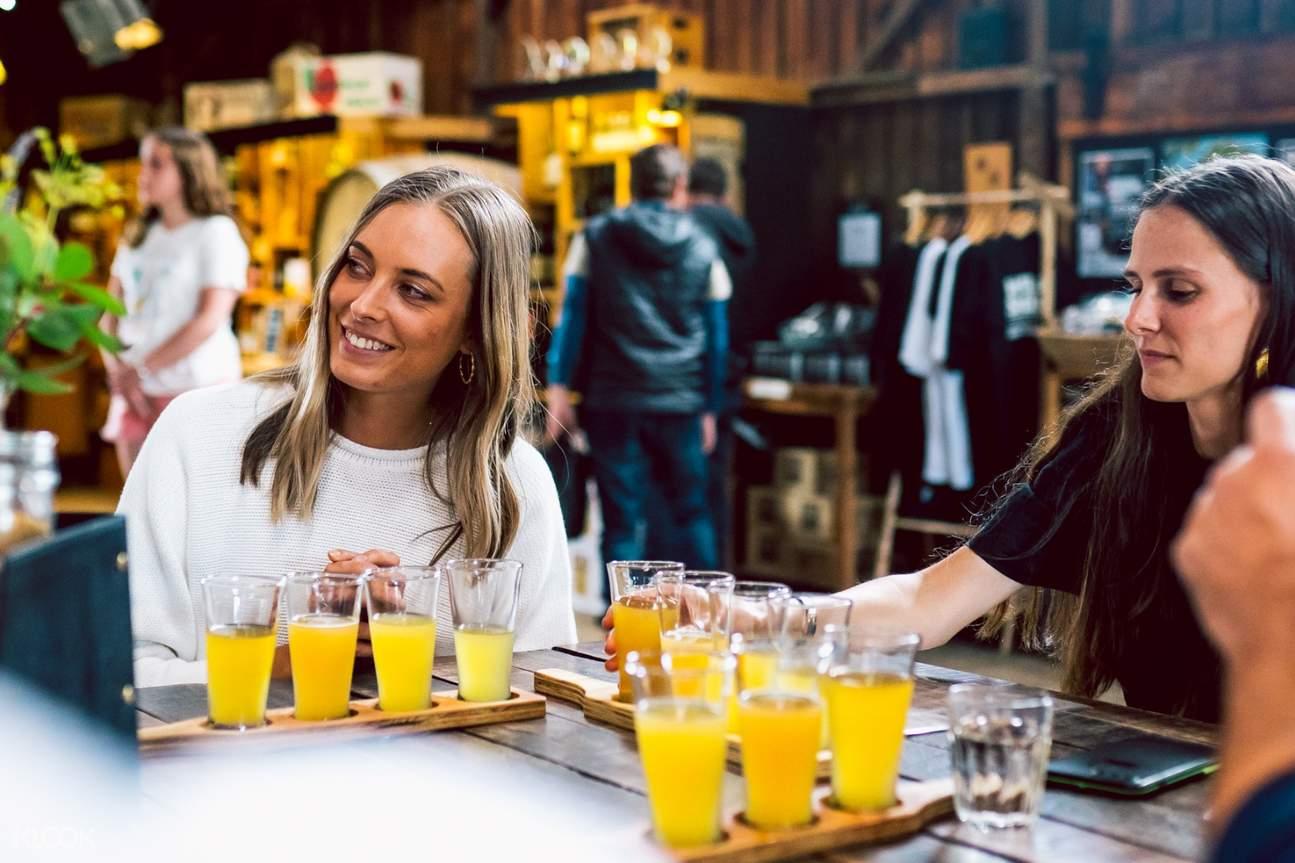 girls and shot glasses during tasmania whisky tour
