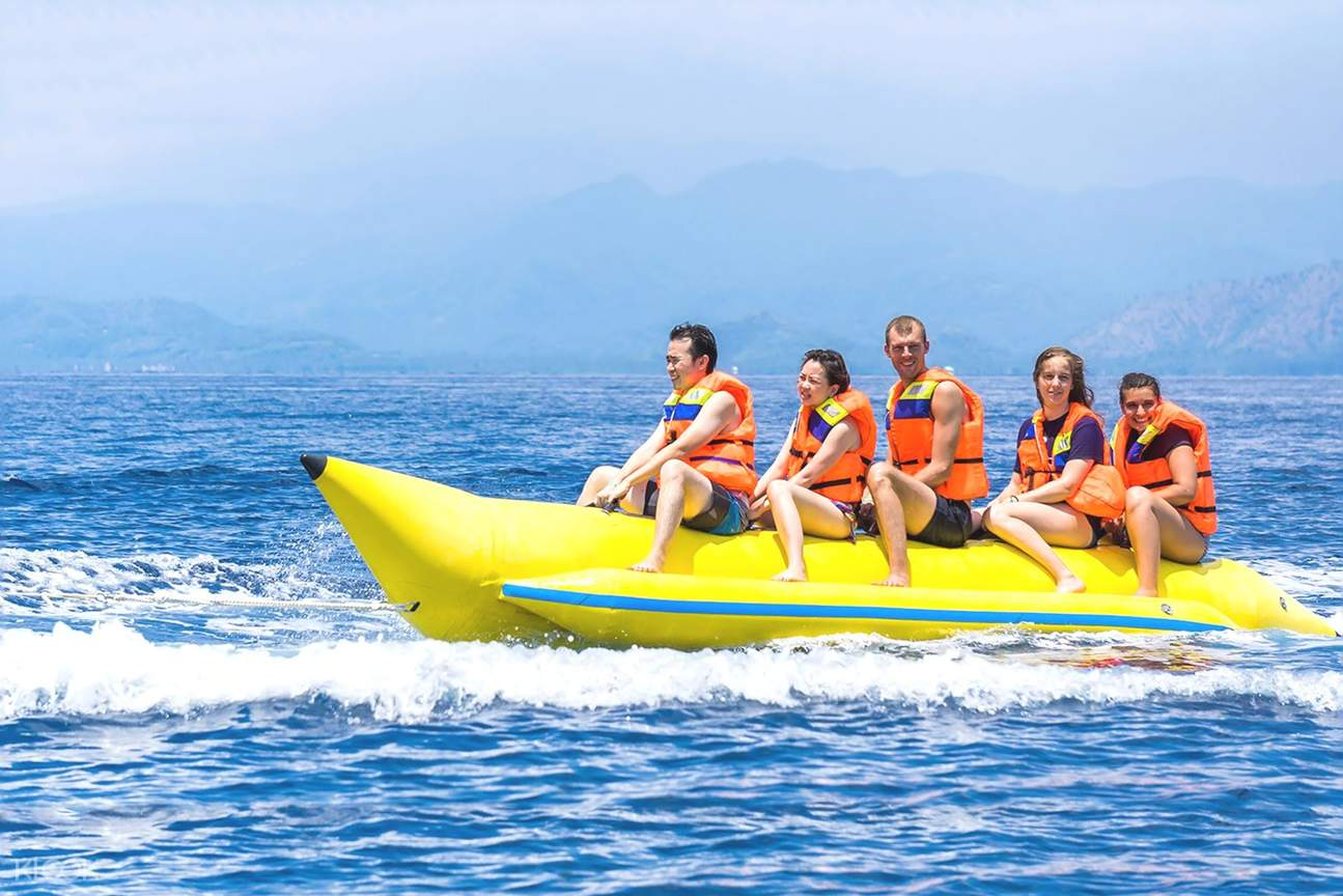 people in boracay while on a banana boat