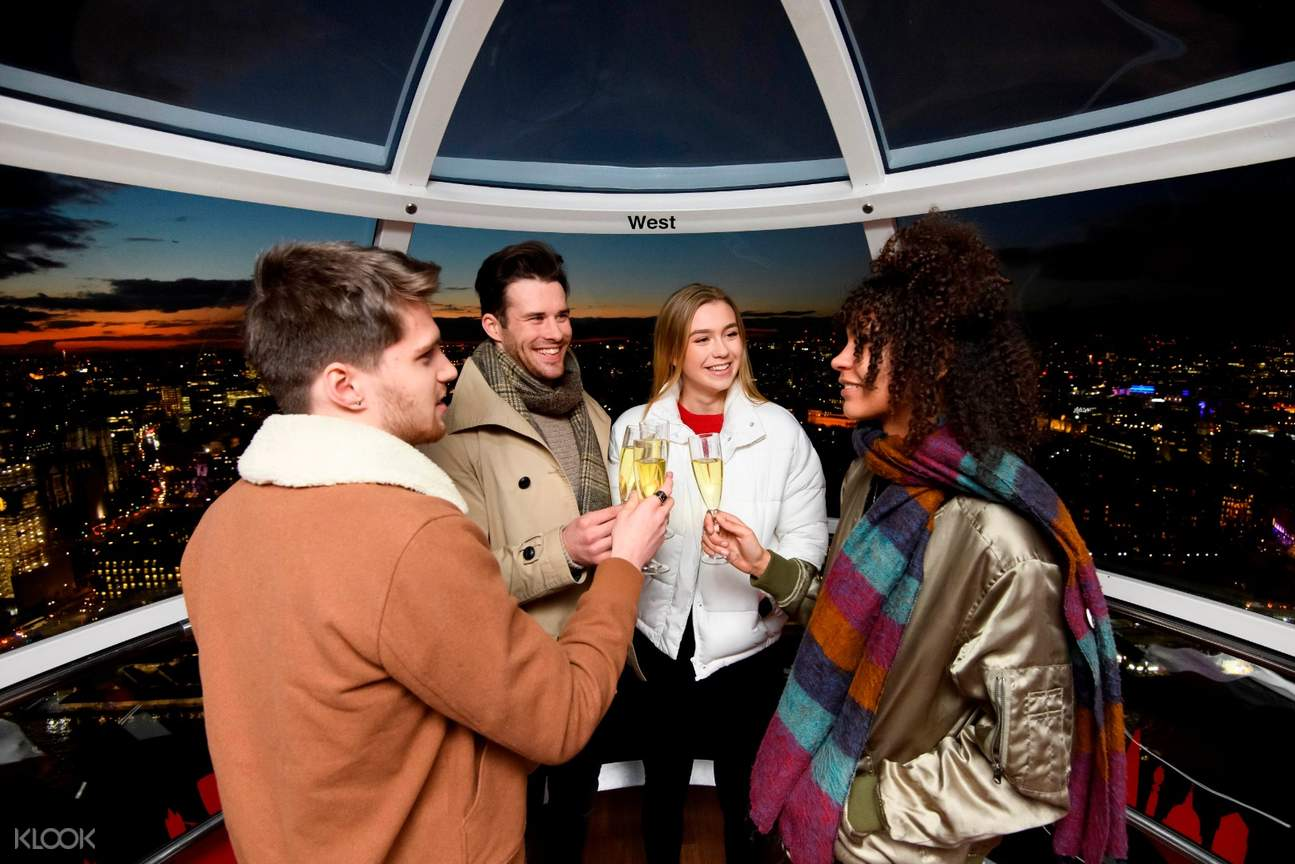 people enjoying champagne onboard the london eye
