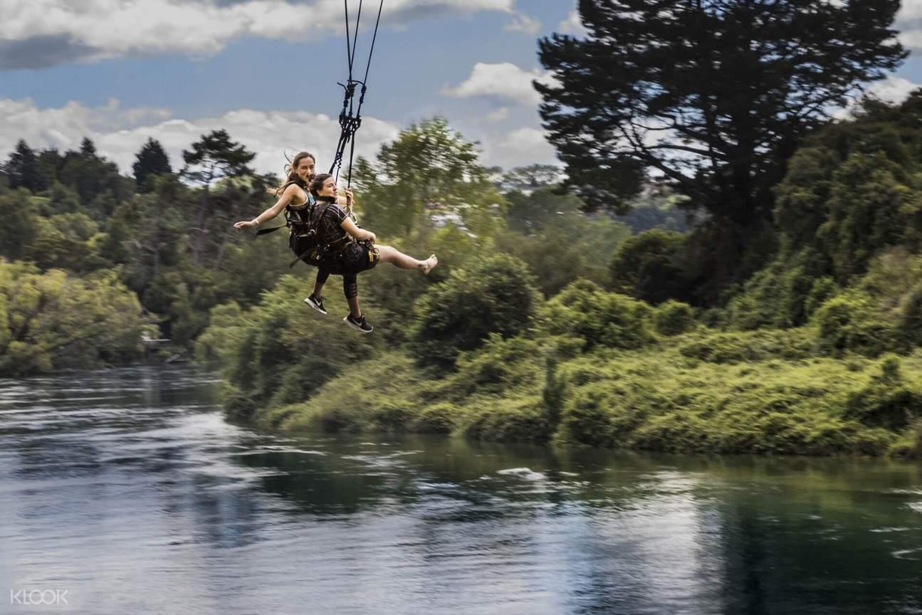 two women swinging