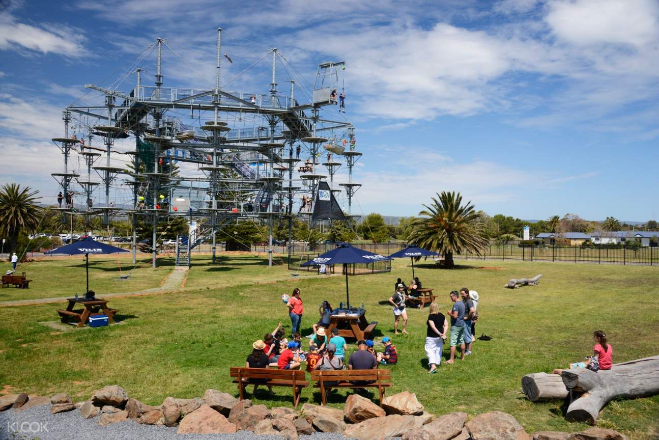 People having a picnic next to Mega Adventure Sky Challenge Experience in Adelaide