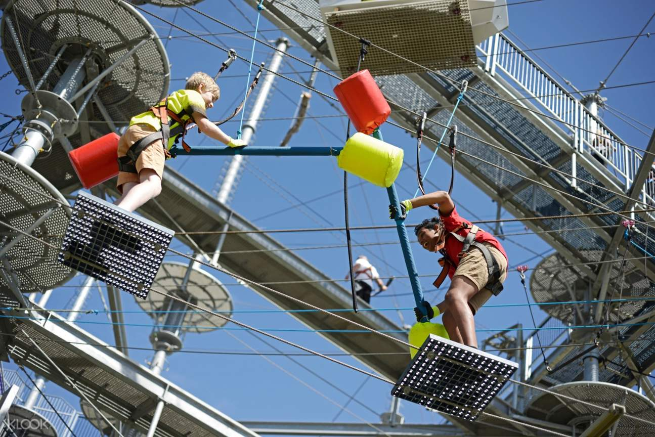 Man and child fighting with sticks in Mega Adventure Sky Challenge Experience in Adelaide