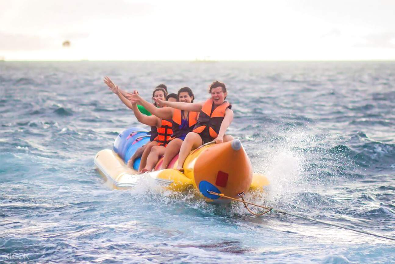 people riding on a banana boat in boracay