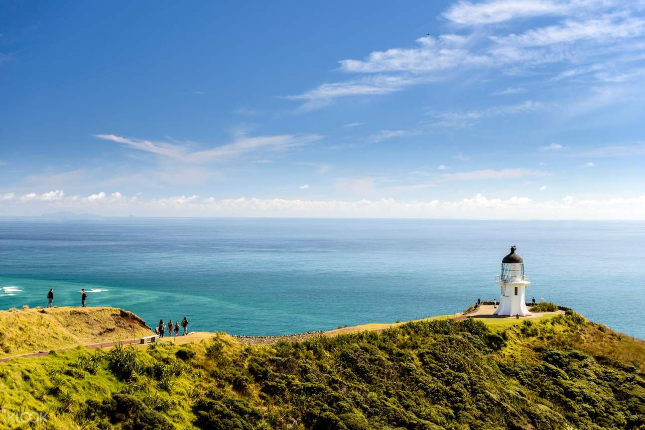lighthouse on cape reinga and scenic backdrop of the pacific ocean and tasman sea