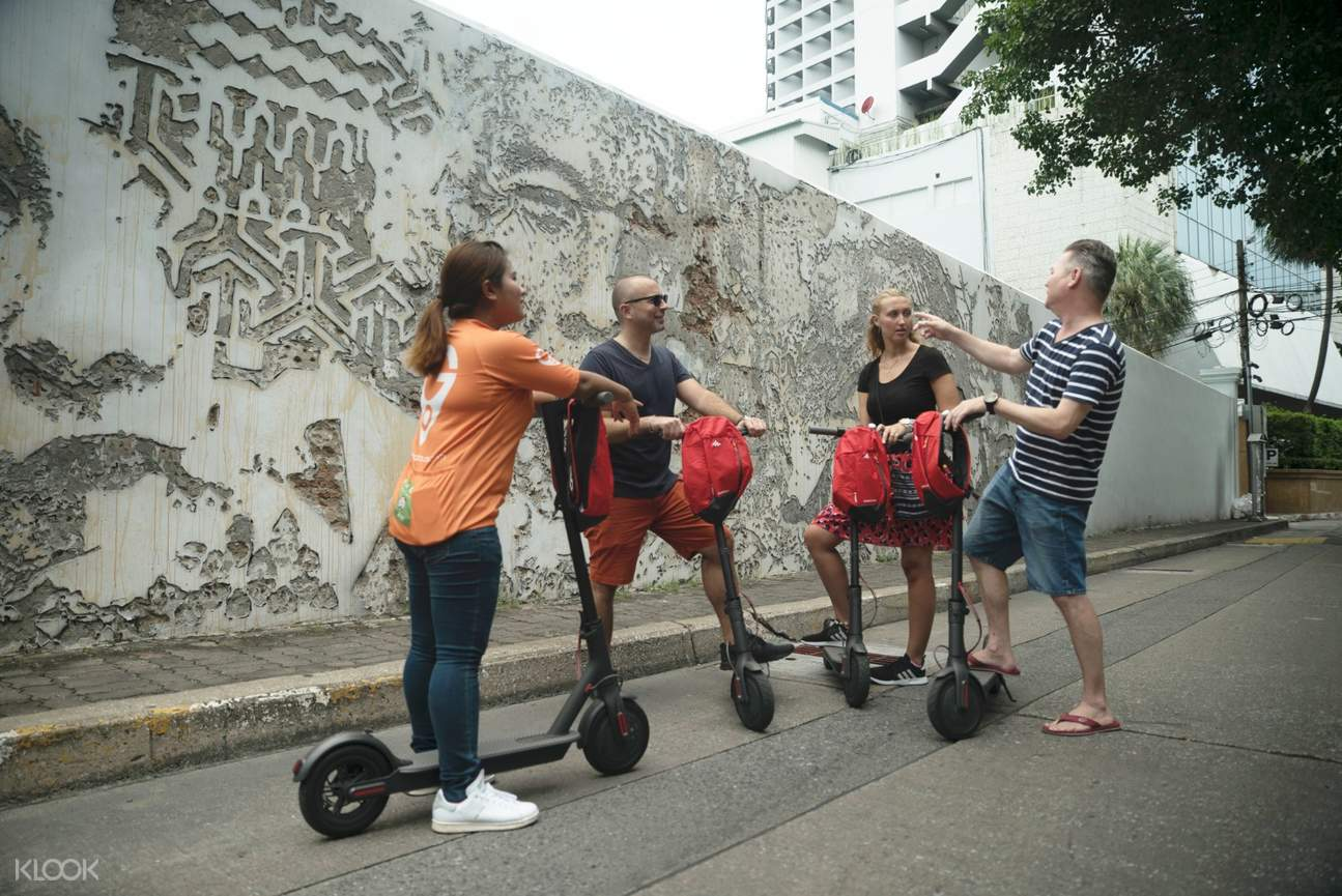 go bangkok e-scooter tour with guide and fellow travelers