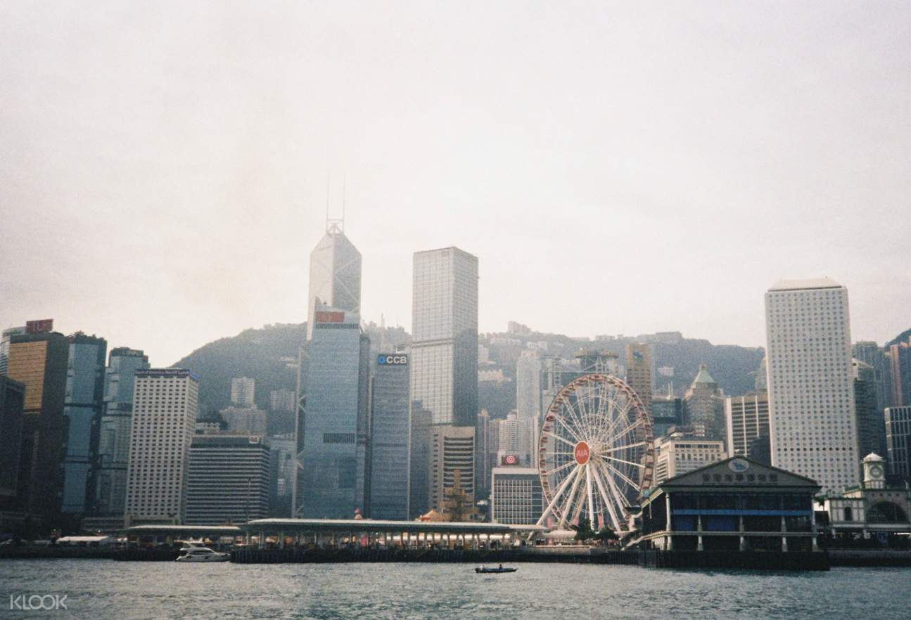 hong kong skyline with hong kong observation wheel