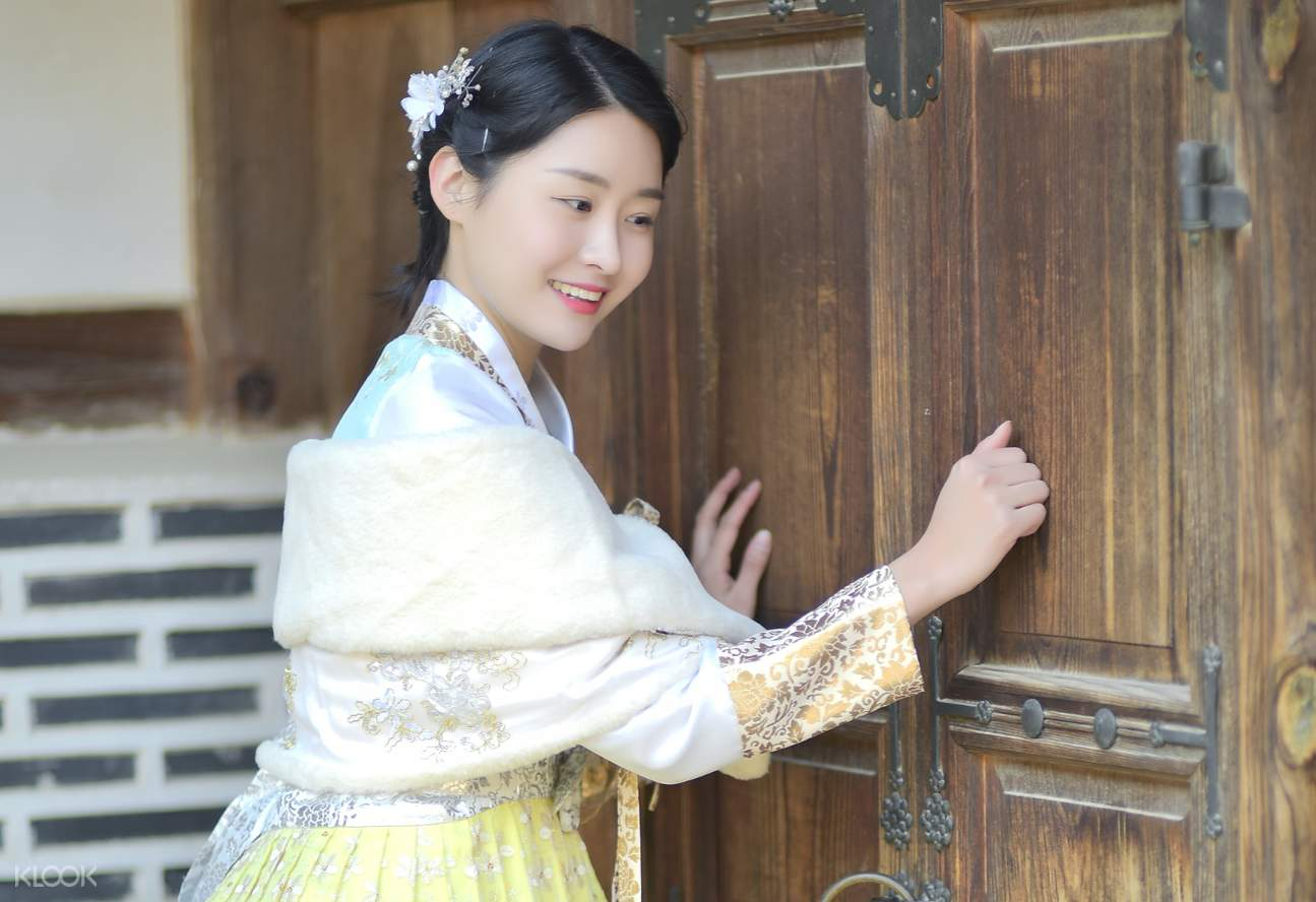 a couple wearing white hanboks