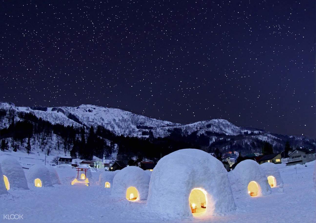 Snow huts illuminated