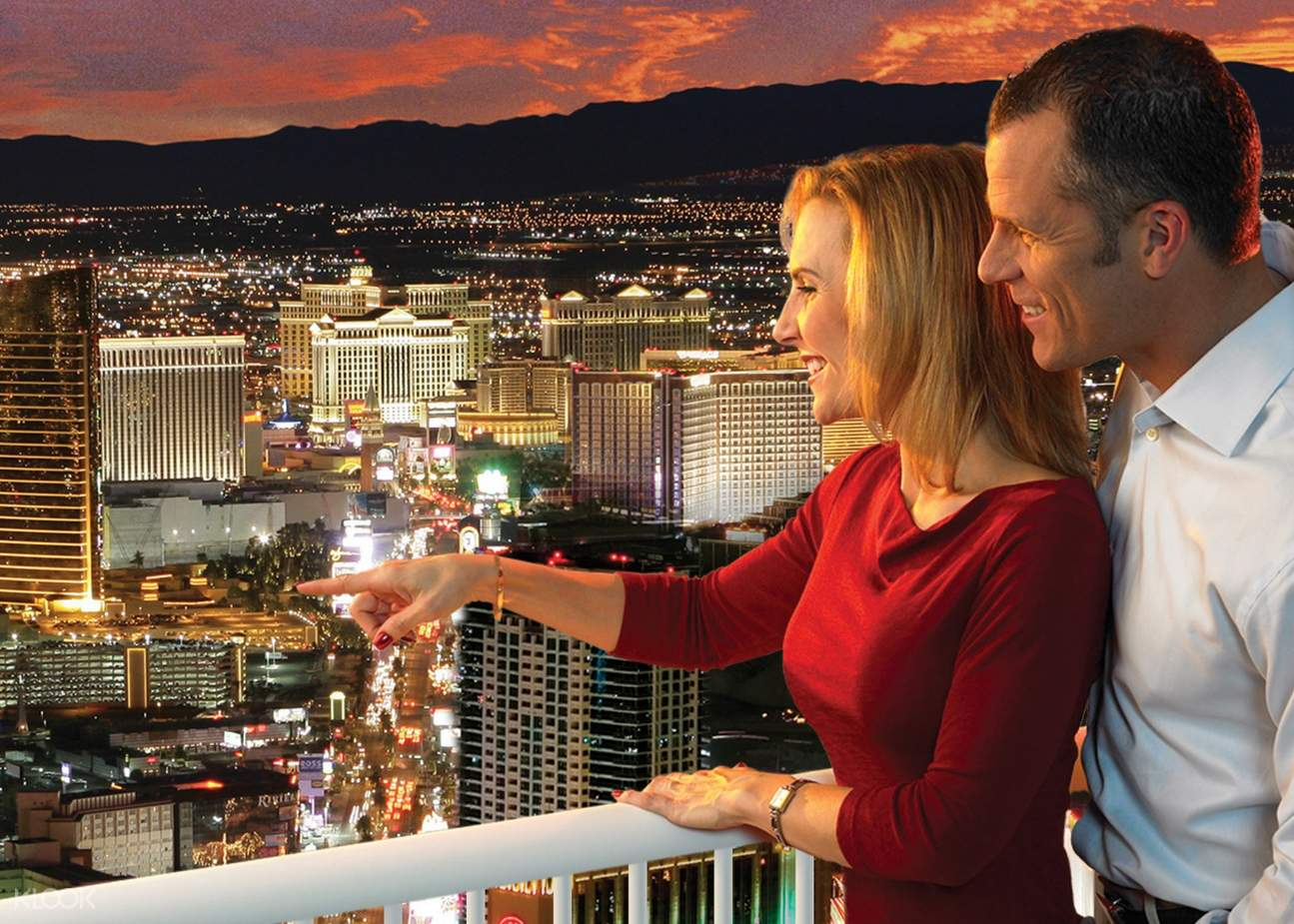 a couple viewing the Las Vegas skyline from the Stratosphere Hotel and Casino