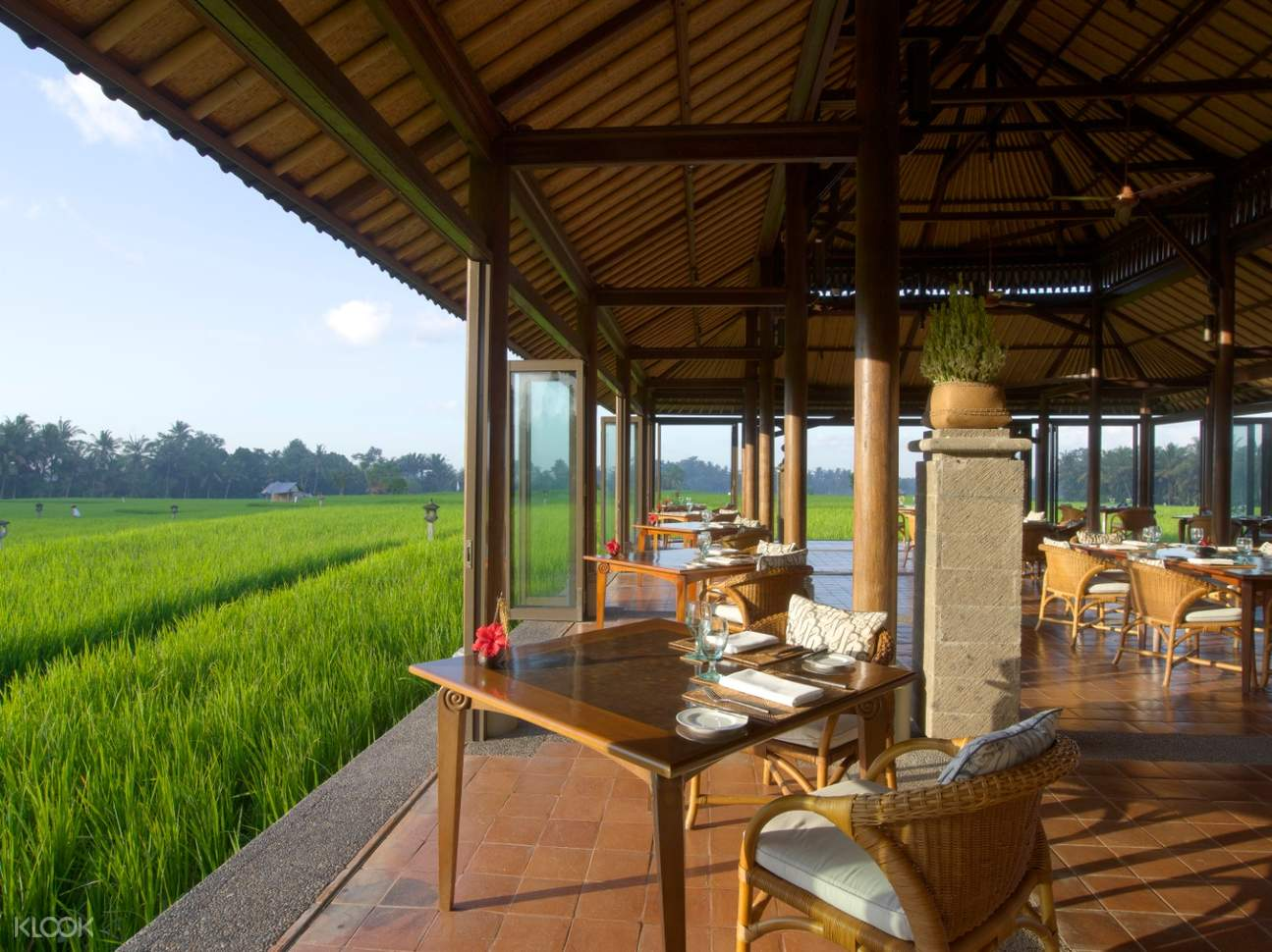 interior of the chedi restaurant with rice paddie in the background