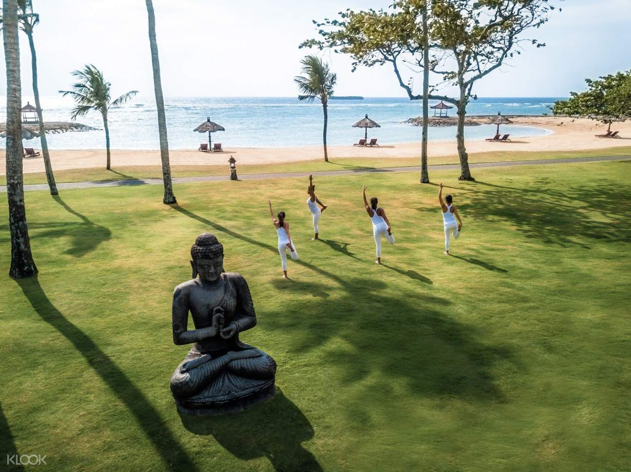 people doing yoga near the beach at club med bali