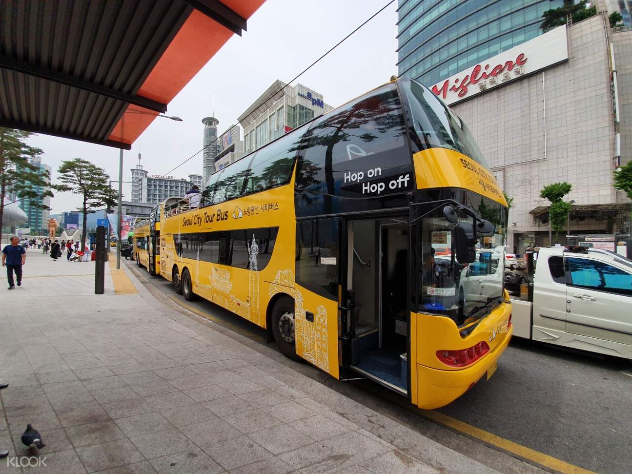yellow double decker bus side view