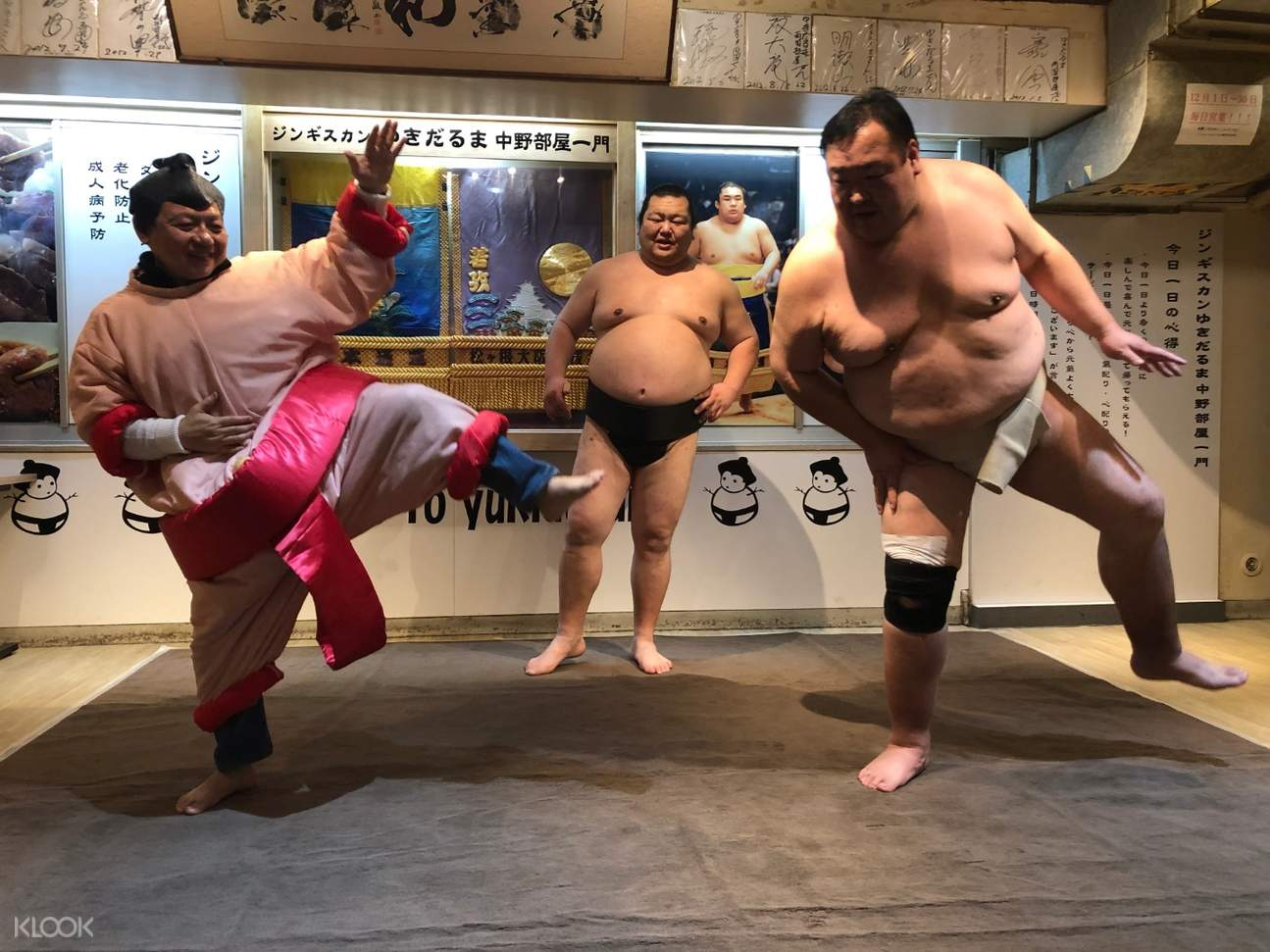 tourists doing sumo poses