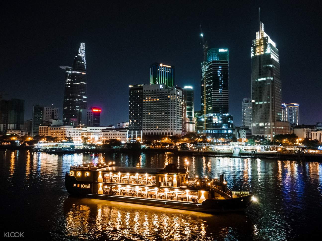 boat cruise with ho chi minh city in the background