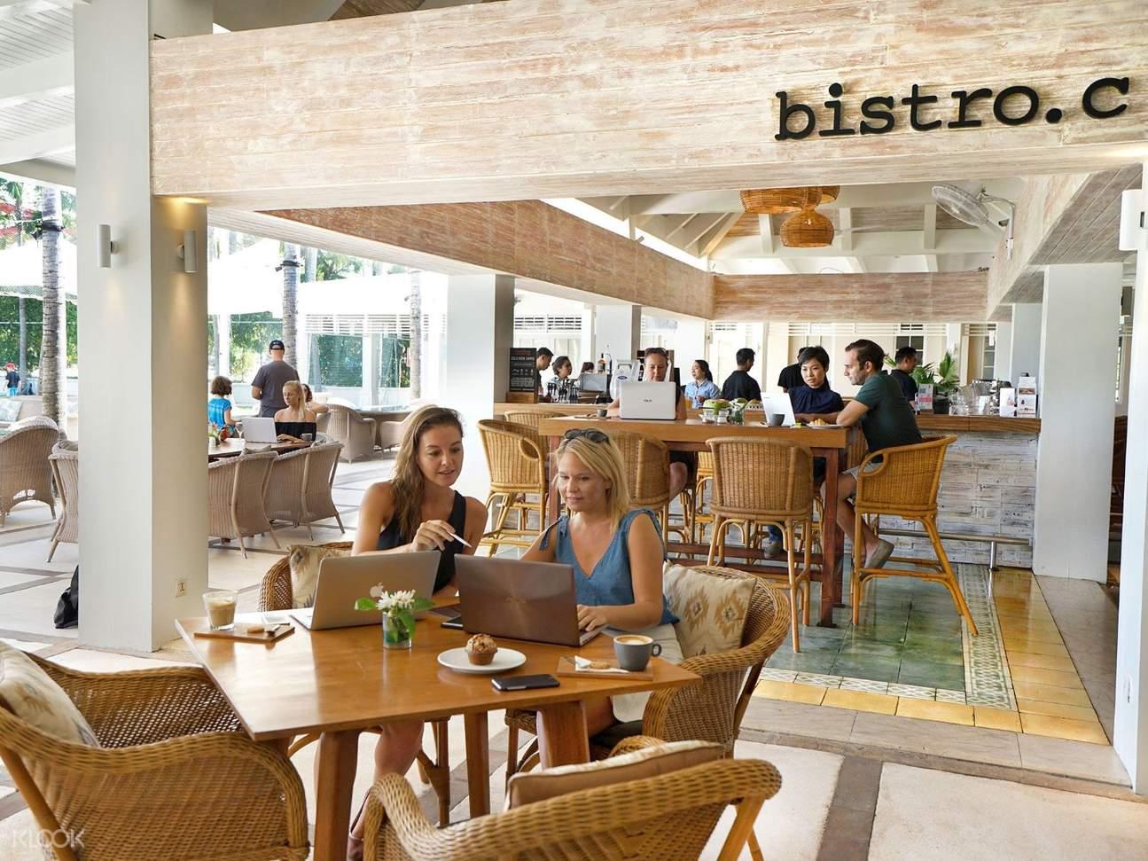 2 women eating inside the bistro restaurant