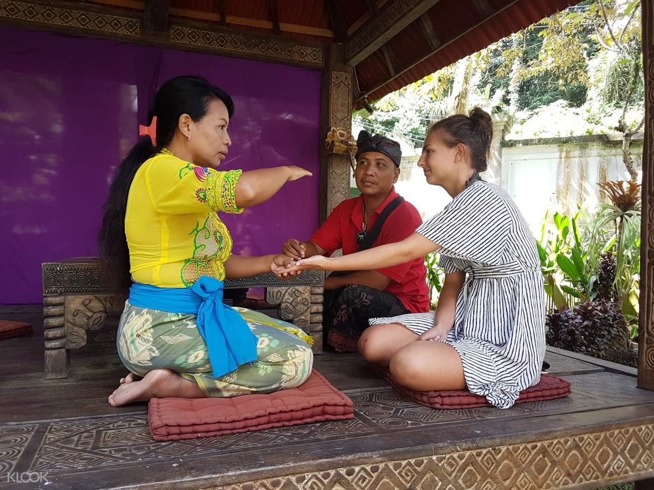 balinese healer performing palm reading