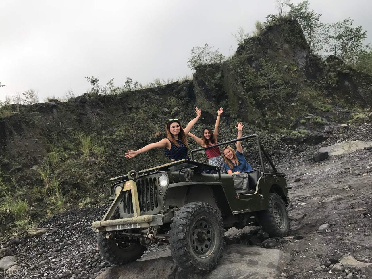 tourists posing on the jeep