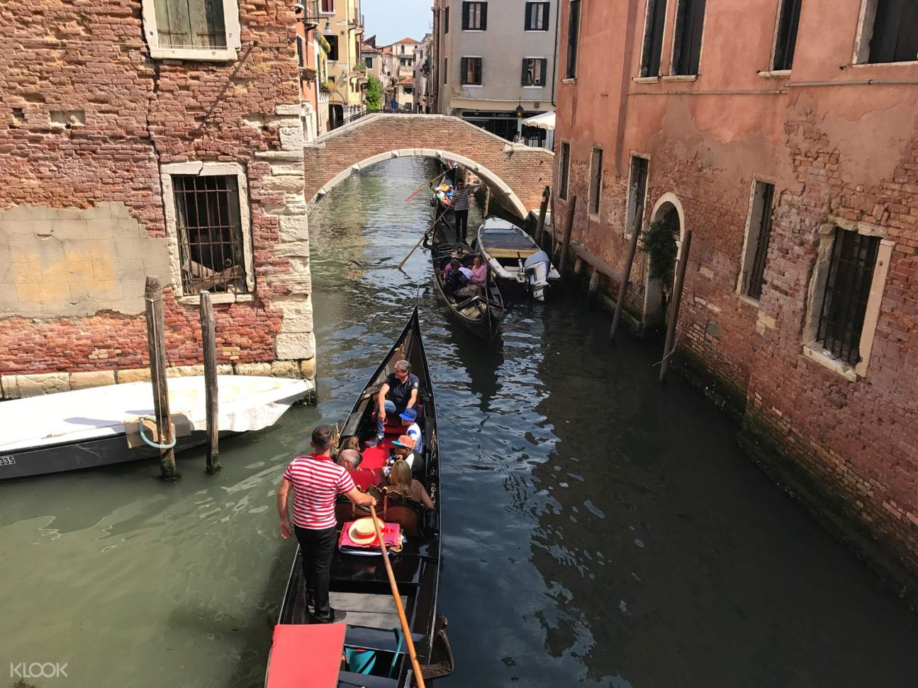 gondola boat accompanying tourists to the grand canal waterways