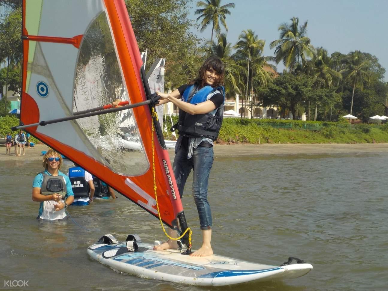 tourist try windsurfing in goa