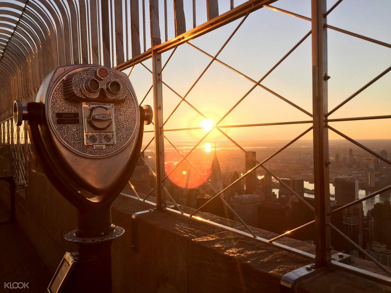 sunset view of new york on top of a building