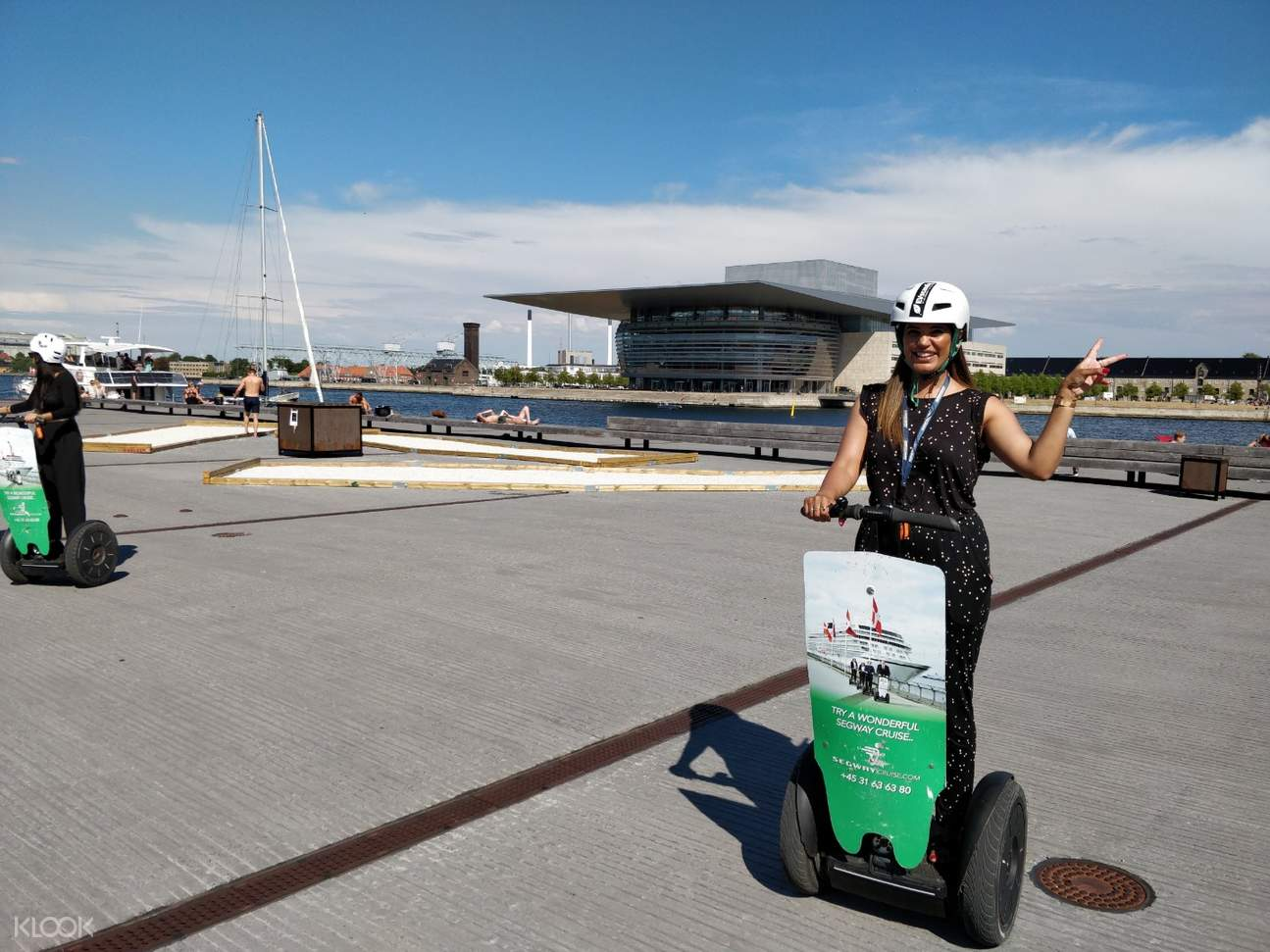 girl on segway near copenhagen opera house