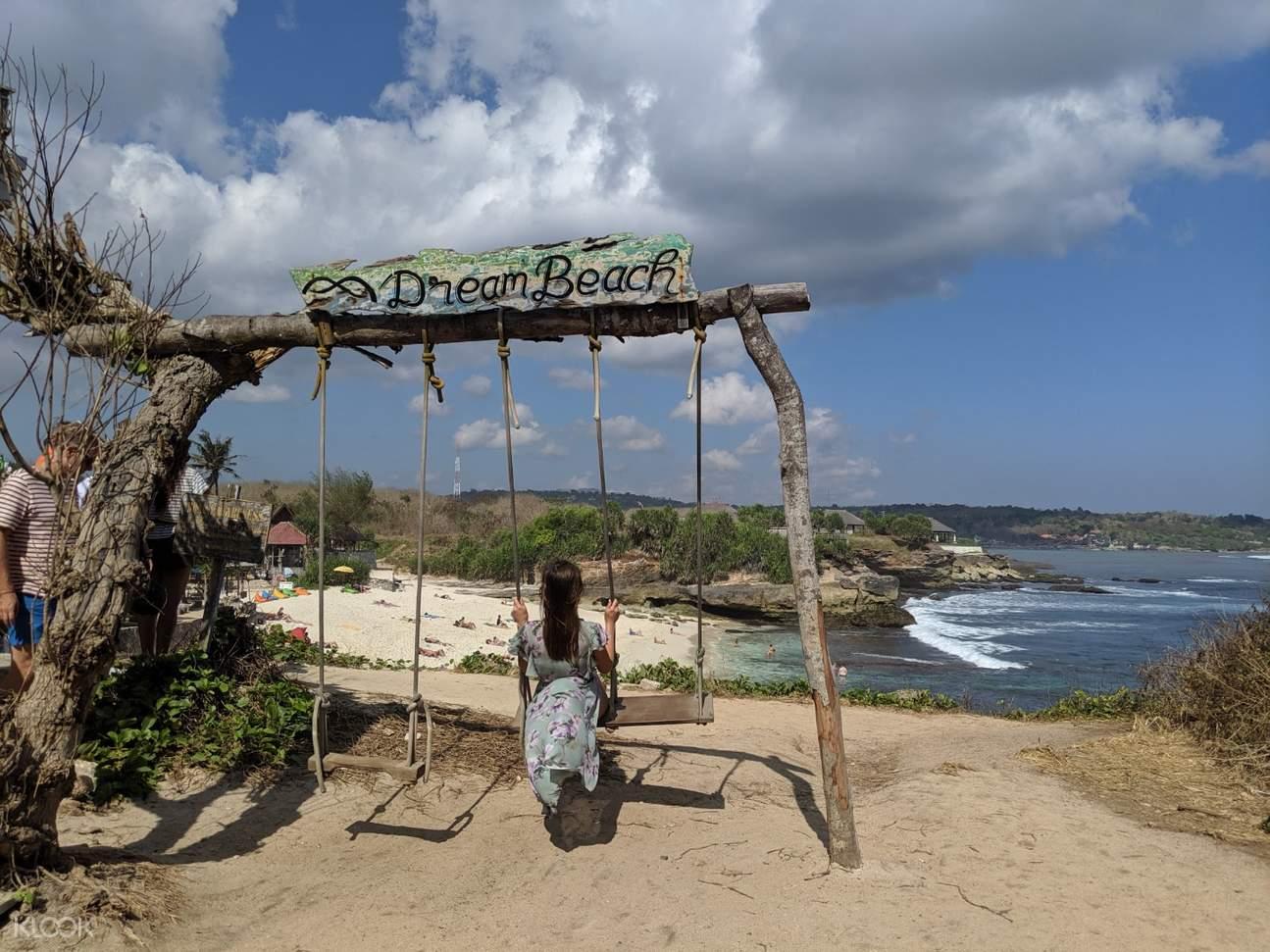 woman on swing at dream beach island