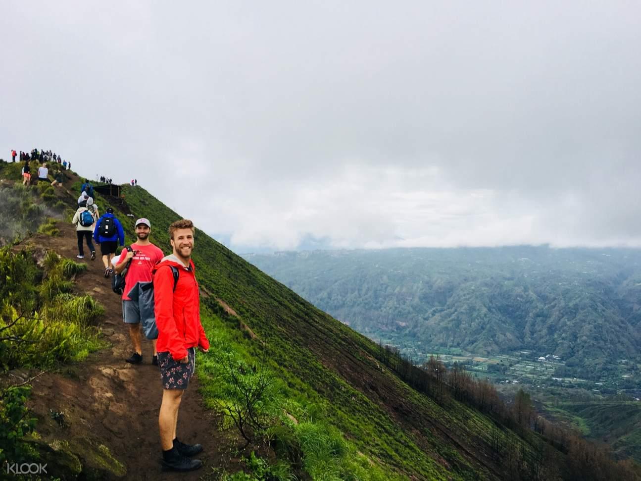 people hiking mount batur