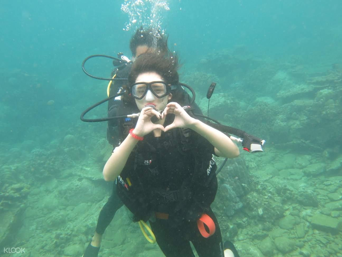 a woman scuba diving in nha trang