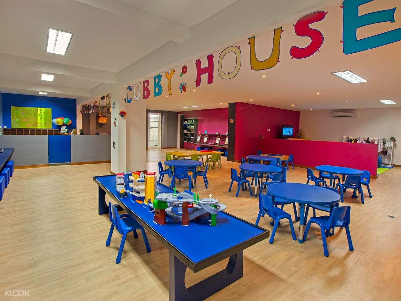 blue tables inside the kids club