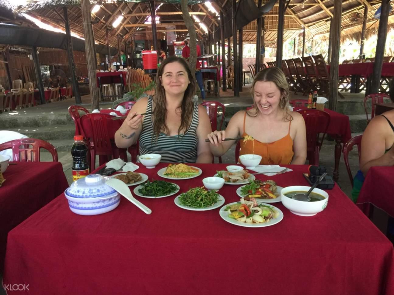 girls eating vietnamese cuisine in charm island