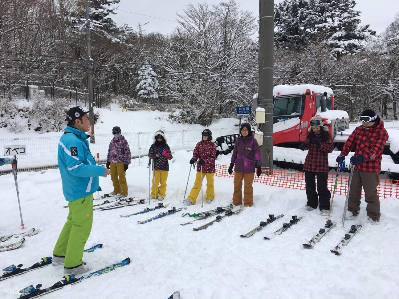 Skiers receiving tips from coach