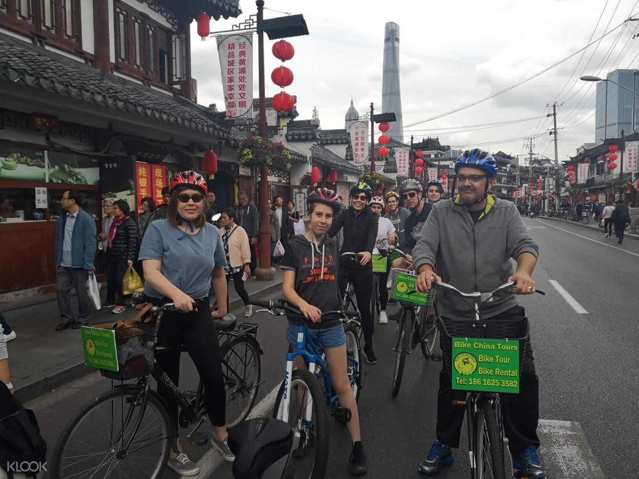 people biking in shanghai streets