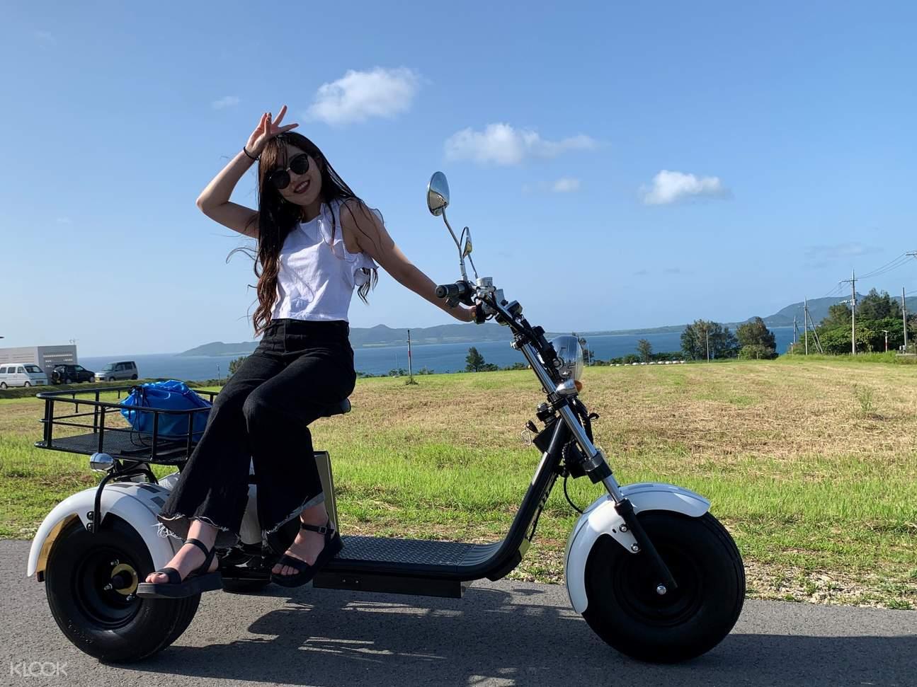 A girl on EV trike