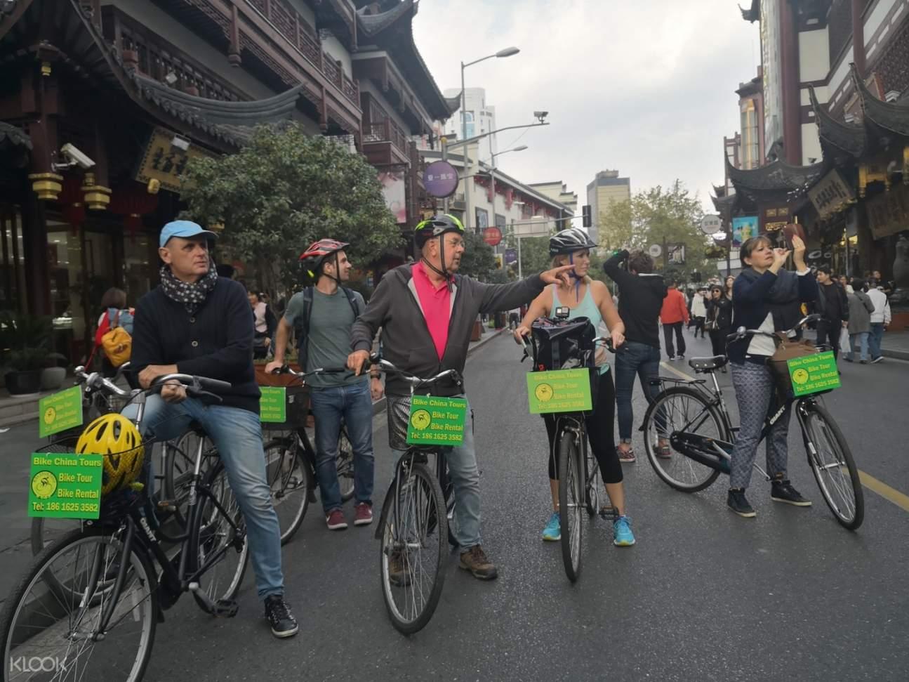 group of tourists biking in shanghai